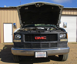 GMC diesel with hood up