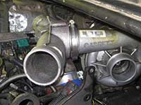 Plenum to turbocharger clamp