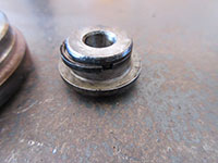 Removing oil ring seal from thrust bearing