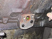 Cleaning engine block mounting surfaces